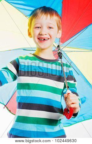 boy with a varicoloured umbrella