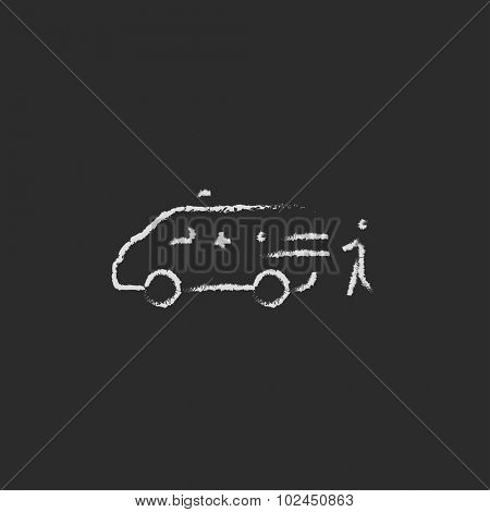 Man with patient and ambulance car hand drawn in chalk on a blackboard vector white icon isolated on a black background.