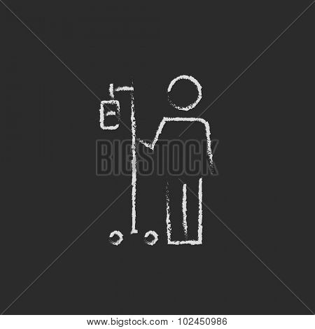 Patient standing with intravenous dropper hand drawn in chalk on a blackboard vector white icon isolated on a black background.