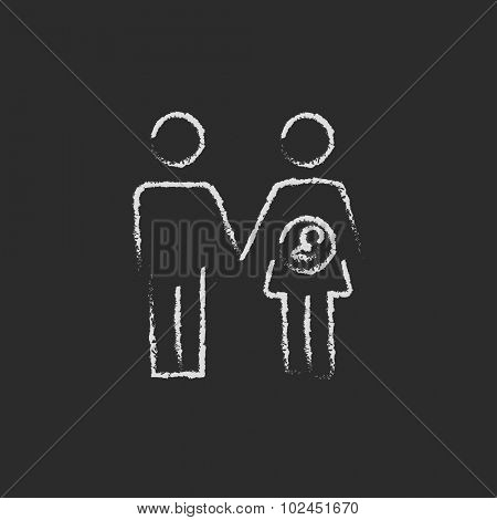 Husband with pregnant wife hand drawn in chalk on a blackboard vector white icon isolated on a black background.