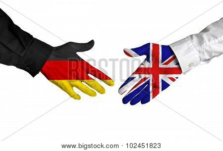 Germany and United Kingdom leaders shaking hands on a deal agreement