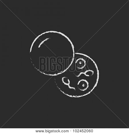 Donor sperm hand drawn in chalk on a blackboard vector white icon isolated on a black background.