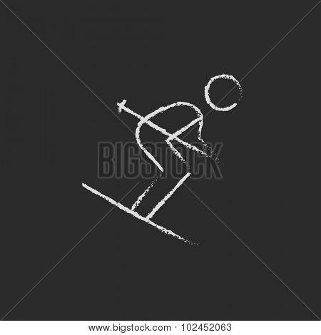 Downhill skiing hand drawn in chalk on a blackboard vector white icon isolated on a black background.