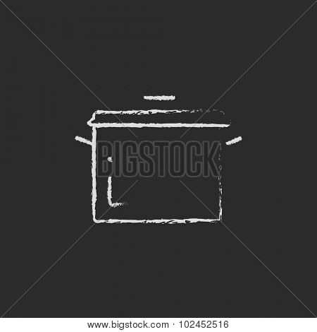Saucepan hand drawn in chalk on a blackboard vector white icon isolated on a black background.