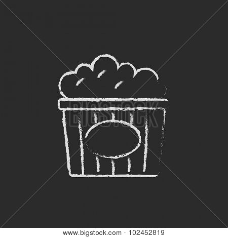 Popcorn hand drawn in chalk on a blackboard vector white icon isolated on a black background.