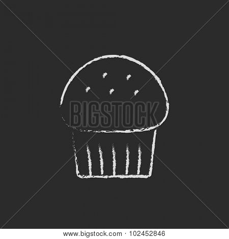 Cupcake hand drawn in chalk on a blackboard vector white icon isolated on a black background.