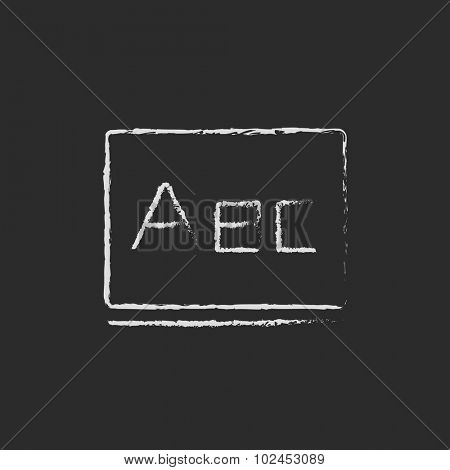 Letters abc on a blackboard hand drawn in chalk on a blackboard vector white icon isolated on a black background.