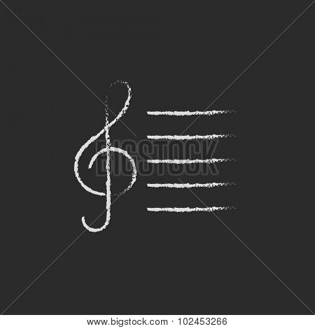 Treble clef hand drawn in chalk on a blackboard vector white icon isolated on a black background.