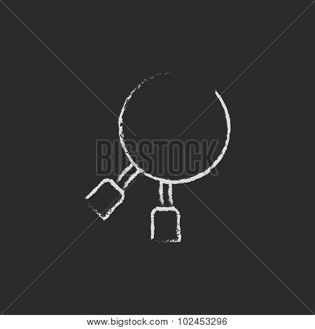Dental pliers hand drawn in chalk on a blackboard vector white icon isolated on a black background.