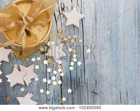 golden present with little stars,