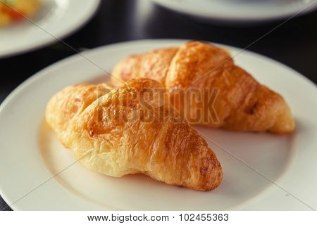 Croissant Breakfast Served With Black Coffee