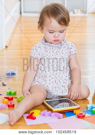 Toddler Girl Using A Tablet Computer