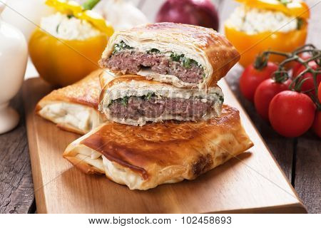 Turkish borek with burger patty wrapped in phyllo pastry