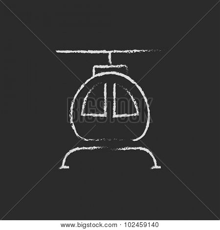 Helicopter hand drawn in chalk on a blackboard vector white icon isolated on a black background.