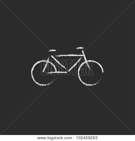 Bicycle hand drawn in chalk on a blackboard vector white icon isolated on a black background.
