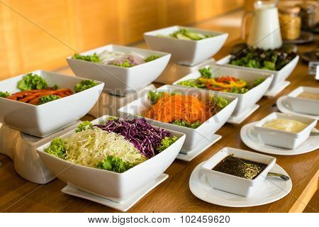 Salad Bar With A Variety Of Vegetables Served Buffet.
