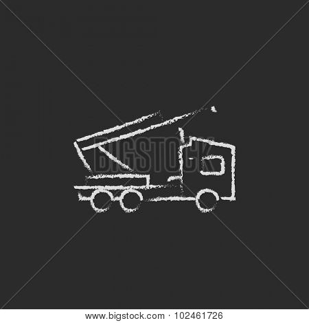 Machine with a crane hand drawn in chalk on a blackboard vector white icon isolated on a black background.