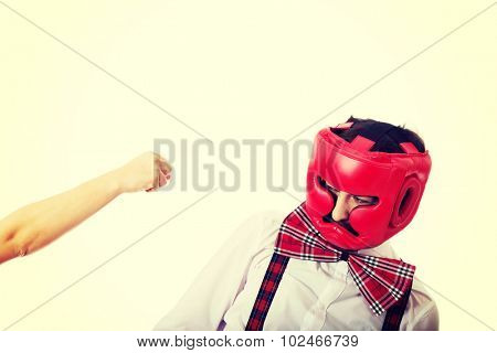 Angry woman slapping across old fashioned man's face.