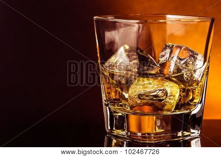 Glass Of Whiskey On Black Table With Reflection, Warm Atmosphere