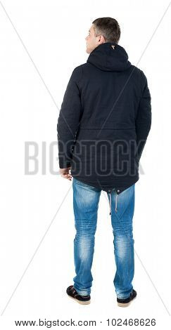 Back view handsome man in winter jacket  looking up.   Standing young guy in parka. Rear view people collection. backside view of person. Isolated over white background. man in jacket looking to right