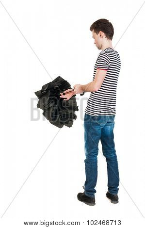 Back view of man in jeans  with umbrella. Standing young guy. Rear view people collection.  backside view of person.  Isolated over white background. The guy in the striped shirt open umbrella