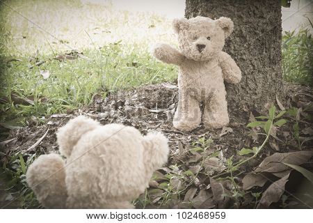 Teddybears at the park, waving goodbye
