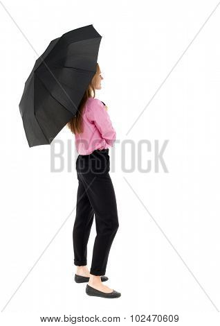 young business woman under an umbrella Rear view people collection.  backside view of person.  Isolated over white background. A girl in pink shirt stands sideways hiding under an umbrella.