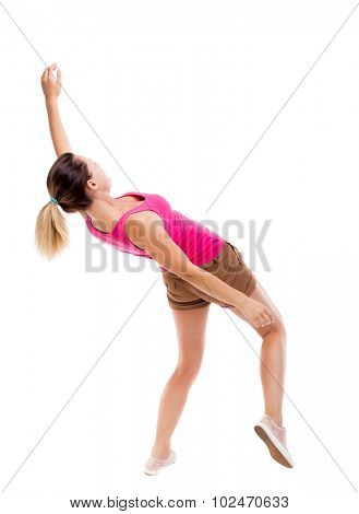 Balancing young woman.  or dodge falling woman. Rear view people collection.  backside view of person.  Isolated over white background. The girl in brown shorts and a pink shirt falls on his back.