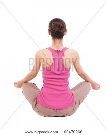 Back view girl sitting in front warm up exercise.  Rear view people collection.  backside view person.  Isolated over white background. African-American woman sitting in a lotus position and meditates