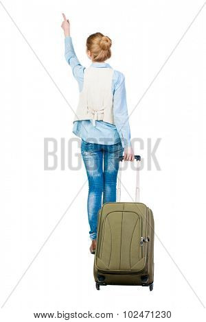 back view of walking  woman  with suitcase pointing. beautiful girl in motion.  backside view of person.  Rear view people collection. Isolated over white background.