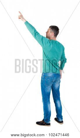 Back view of  pointing young men in jeans.  Rear view people collection.  backside view of person.  Isolated over white background. The guy in green jacket stands sideways and shows a finger at right