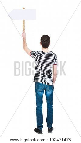 Back view man showing sign board. man holds information plate. Rear view people collection. backside view of person. Isolated over white background. The guy in striped shirt points to right pointer.