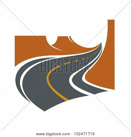 Road passes through canyon between brown cliffs