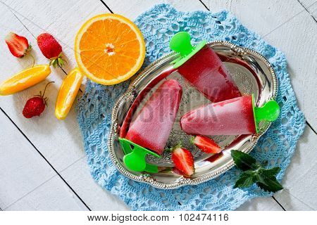 Strawberry Ice Cream Popsicle Orange On A White Wooden Background