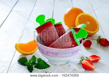 Strawberry Ice Cream Popsicle Orange On A White Table
