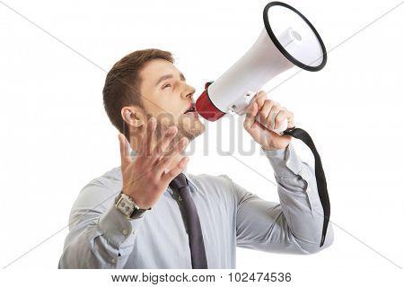 Handsome businessman shouting through megaphone.