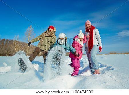 Ecstatic family having fun in snowdrift
