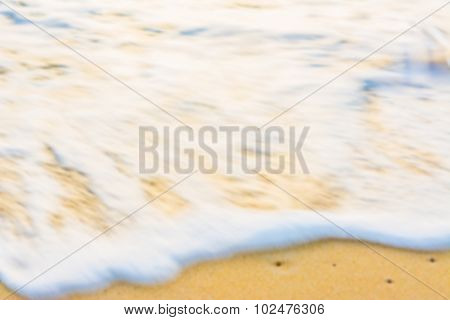 Blur Image Of Sea Shore And Yellow Sand  For Background Usage.