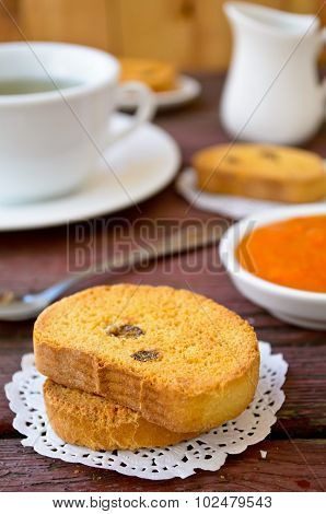 Fresh baked biscottis with raisins and apricot jam