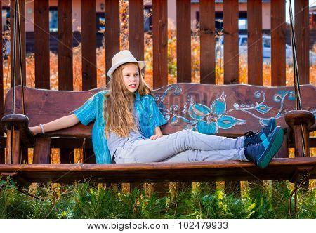 Girl On Garden Swing 1