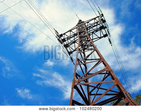 Upward View Diagonally To The Power Line And Pylon