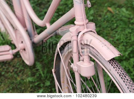 Detail Of Old Bicycle With The Bottle Dynamo On The Front Wheel