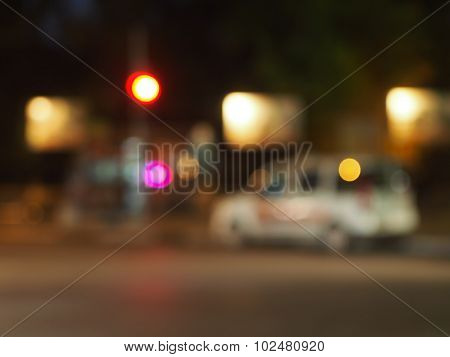 Defocused Silhouette Of The Car And Traffic Lights