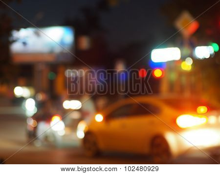 Blur And Defocused Silhouette Of The Car And Traffic Lights