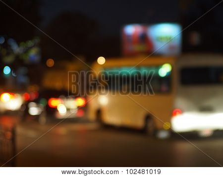 Abstract And Blur Night Scene With Bus And Headlights