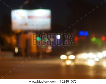 Defocused Lights On The Stream Of Cars