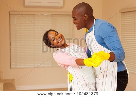 lovely african american couple dancing in their new home