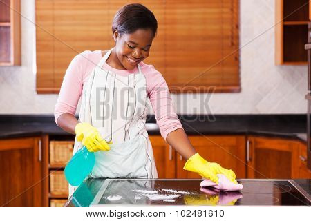 pretty young african woman doing house chores