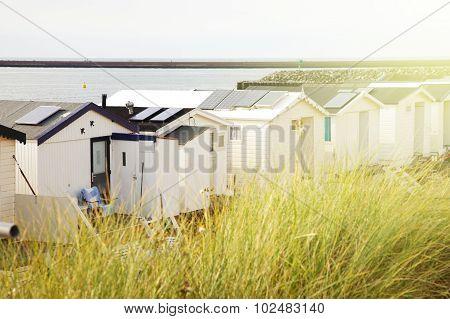 Row Of Dutch Beach Houses With Warm Sun Effect