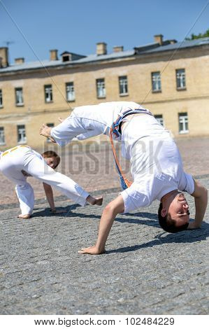 Two strong capoeira experts fighting